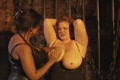 Huge Breasted Redhead Enjoys S & M Games