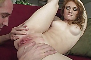 Redhead with meaty butt banging on sofa.