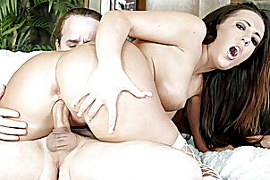 Oiled up brunette riding and blow guy.