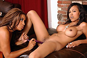 Two excited ebony babes strip down and lick each others feet.