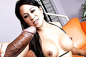 When young Asian babe Kayme Kai got into the porn industry, she wanted one thing – big cocks!  She even had her tits done so that she could get better jobs, and today her hard work and persistence finally pay off.  She is teamed with big dick black pornstar Sledge Hammer, and as soon as she sees that massive pole she knows that she has found her calling in life.  She sucks it real good, blowing her man like a dirty little street whore rather than a high-class Asian escort.  She's a petite girl, so Sledge pulls her on top, impaling her from the bottom up with his truly enormous rod.  His cock stretches this little Asian bitch out good!
