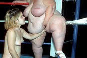Midget And Two Fatties Fuck In The Ring