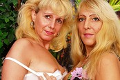 Mature Eve Bangs Martina's Pussy With Her Favorite Strap-On