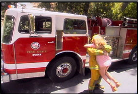 Evan arrives in a firetruck to fulfil her female fantasy