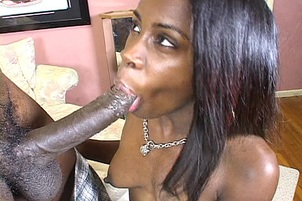 Black Babe Sucks Back a Big Black Flesh Baton