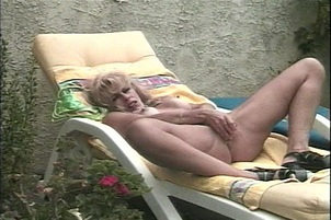 Pretty Blonde Sunbathing Outside Gets Horny and Toys Her Pussy