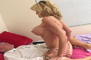 A MILF Is Seduced By Two Younger Guys