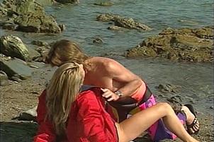 Busty Lifeguard Doggy Banged On Beach