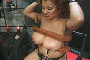 Dominatrix Tortures Some Natural Breasts