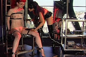 Two Hot Lesbians With A Vibrator In A Bondage Scene