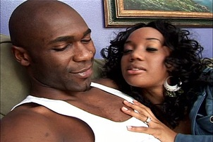 Two Ebony Sluts Share A Large Stiff Cock