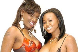 Yummy Black Lesbos Playing With Dildos