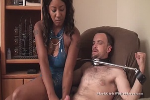 Busty Black Slut Jerks Off Her Tied Down White Slave